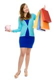 Woman with piggybank and shopping bags Royalty Free Stock Photography