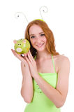 The woman with piggybank on white Royalty Free Stock Images
