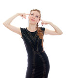 Woman with pigtail in black dress. Isolated on white Royalty Free Stock Images
