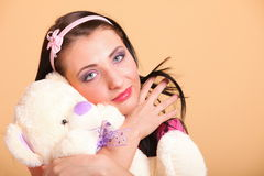 Woman with pigtails hugging teddy bear toy Stock Images