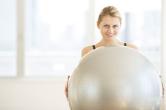 Woman With Pilate Smiling In Health Club Stock Photos