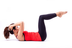 Pilates action. Woman in pilates action ( isolated Royalty Free Stock Photography