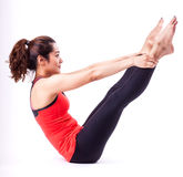 Pilates action. Woman in pilates action ( isolated Stock Photos