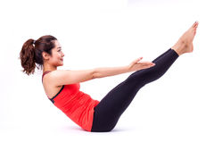 Pilates action. Woman in pilates action ( isolated Stock Photography