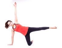 Pilates action. Woman in pilates action ( isolated Stock Image