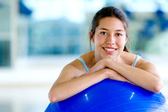 Woman with pilates ball Stock Images