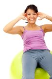 Woman with a pilates ball Royalty Free Stock Photos