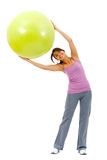 Woman with a pilates ball Royalty Free Stock Photo