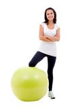 Woman with a pilates ball Stock Photo