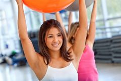 Woman with a pilates ball Royalty Free Stock Images