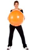 Woman with a pilates ball Stock Image