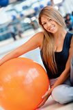 Woman with a pilates ball Stock Photography