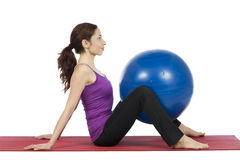 Woman with a pilates ball Stock Images