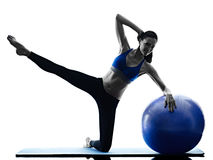 Woman pilates ball exercises fitness isolated Royalty Free Stock Images