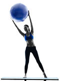 Woman pilates ball exercises fitness isolated Stock Image