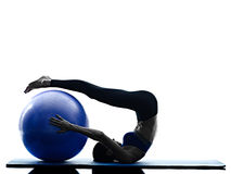Woman pilates ball exercises fitness isolated Royalty Free Stock Image