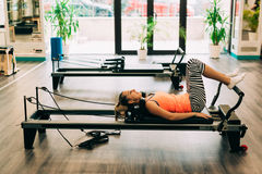 Woman in a pilates class Royalty Free Stock Photos