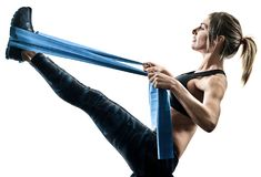 Woman pilates fitness elastic resistant band exercises silhouett Stock Images
