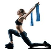 Woman pilates fitness elastic resistant band exercises silhouett royalty free stock images