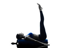 Woman pilates roller exercises fitness isolated Royalty Free Stock Photos