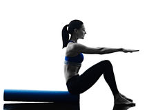 Woman pilates roller exercises fitness isolated Royalty Free Stock Images