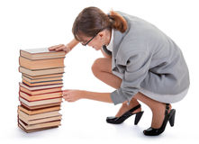 Woman and a pile of books Stock Image