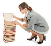 Woman and a pile of books Stock Photo