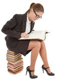 Woman and a pile of books Royalty Free Stock Photos