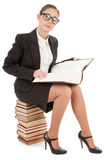 Woman and a pile of books. Business woman  in spectacles and a pile of books Stock Image