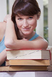 Woman with pile of books Stock Photo