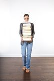 Woman with a pile of books Royalty Free Stock Photo