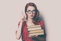 Woman with pile of books. Beautiful young woman with pile of books Royalty Free Stock Photography
