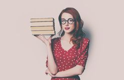 Woman with pile of books. Beautiful young woman with pile of books Stock Image