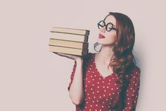 Woman with pile of books. Beautiful young woman with pile of books Stock Photo