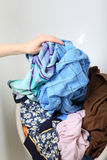 Woman Pile of dirty laundry washing Royalty Free Stock Photo