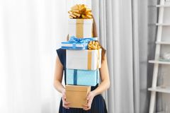 Woman with pile of presents. At home royalty free stock photo
