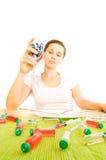 Woman and pill Stock Photos