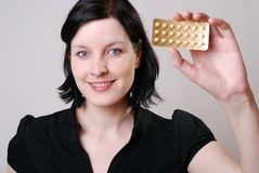 Woman with pill Stock Images