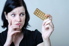 Woman with pill Royalty Free Stock Images