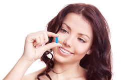 Woman with a pill Stock Photography