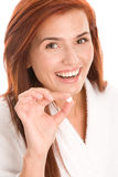 Woman with pill. Portrait of young woman with pill isolated on white background Royalty Free Stock Photography