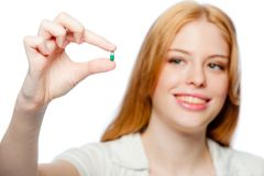 Woman With Pill Royalty Free Stock Image