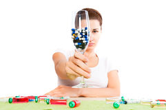 Woman and pill close up Royalty Free Stock Image
