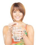 Woman with pill and glass of water Stock Photos