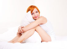 Woman with a pillow Stock Images