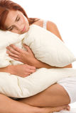 Woman with pillow. Portrait of young woman with pillow Royalty Free Stock Photo