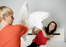 Woman in a pillow fight royalty free stock images