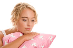 Woman with pillow. Portrait of young sad woman with pillow Royalty Free Stock Photo