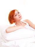 Woman with pillows Royalty Free Stock Image