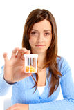 Woman with pills Stock Photography